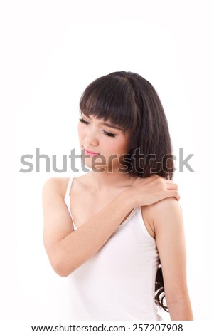 woman suffers from heavy shoulder pain or stiffness - stock photo