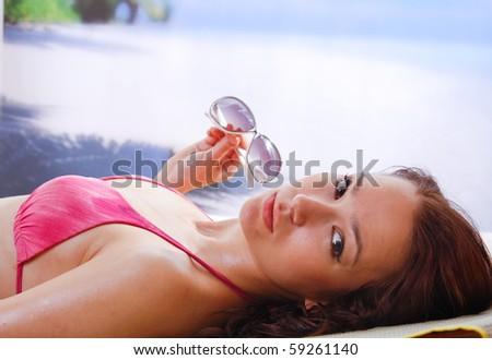 woman sunbathing in beach chair - stock photo