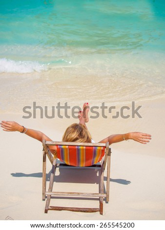 Woman suntanning at the beach in Thailand