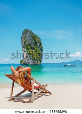 Woman suntanning at the beach in Thailand - stock photo