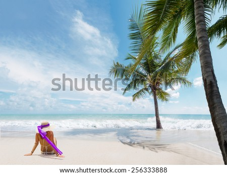Woman suntanning on the tropical beach - stock photo