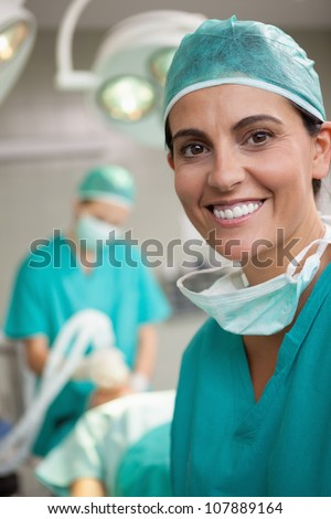 Woman surgeon smiling in a surgical room