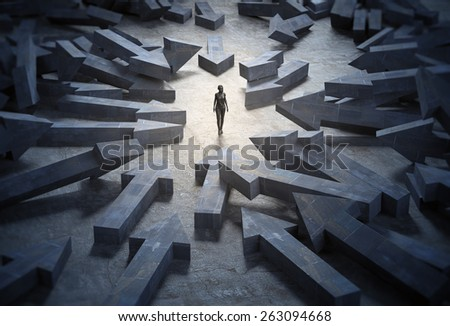 Woman surrounded by huge arrow shaped blocks - stock photo