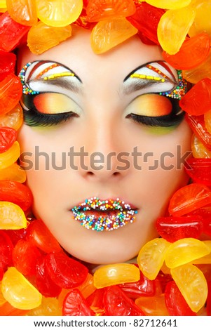 woman sweet candy caramel with beautiful make-up young attractive - stock photo