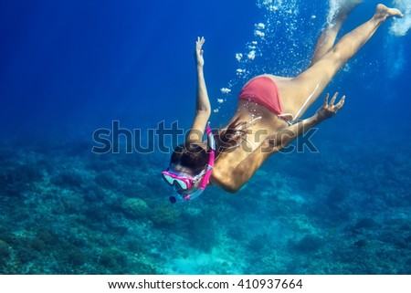 Woman swim underwater in tropical sea. Vacation concept - stock photo