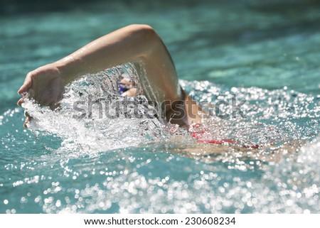 woman swimming in a pool - stock photo