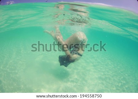 Woman swimming in the ocean