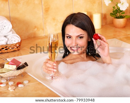 Woman swimming of bath tub. - stock photo