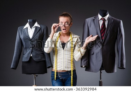 Woman tailor working on clothing - stock photo