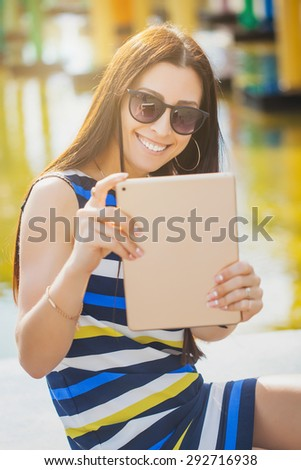 woman take a photo with tablet  - stock photo