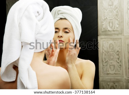 Woman take care of her face. - stock photo