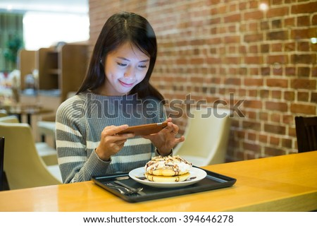 Woman take photo on her food - stock photo