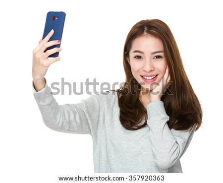 Woman take selfie by mobile phone