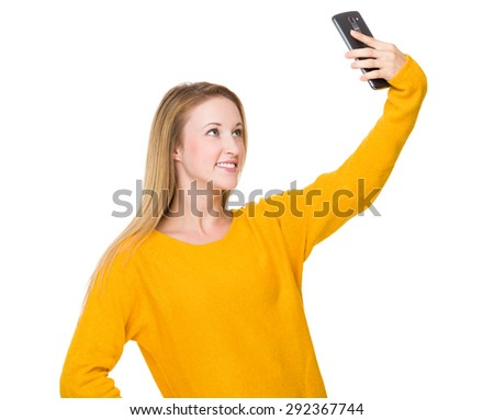 Woman take selfie by using mobile phone