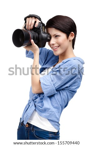 Woman takes images holding photographic camera, isolated on a white - stock photo