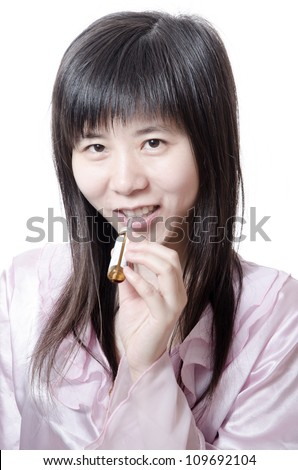 woman takes oral liquid drug isolated - stock photo