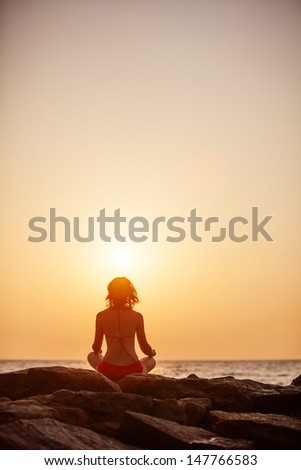 Woman takes rest at the sea shore