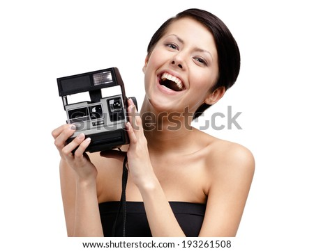 Woman takes snaps with cassette photographic camera, isolated on white