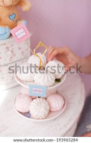 woman takes the marshmallows - stock photo