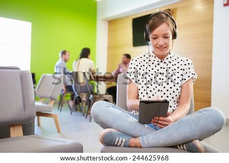 Woman Taking A Break Working In Design Studio - stock photo