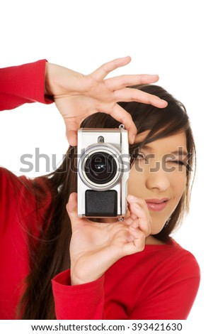Woman taking a photo with camera. - stock photo