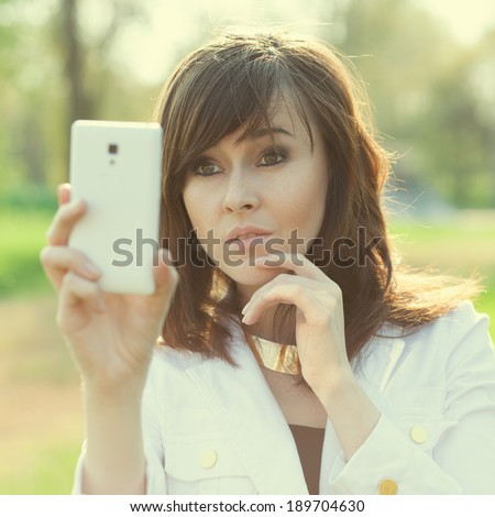 Woman taking a selfie or shooting - stock photo