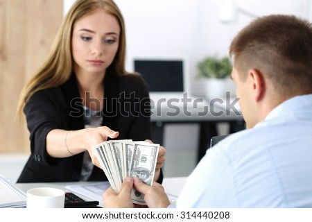Woman taking batch of hundred dollar bills. Venality, bribe, corruption concept - stock photo