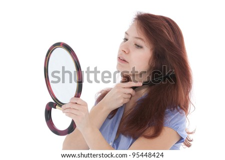 Woman taking care of her hair. Studio shot against white background.