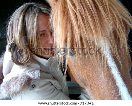 Woman taking care of her horse (image contains some noise)