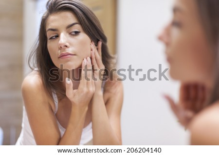 Woman taking care of her skin  - stock photo