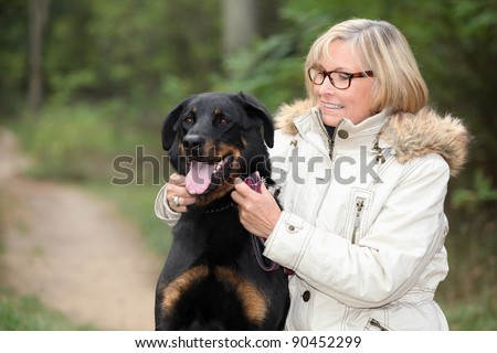 Woman taking her dog out for a walk