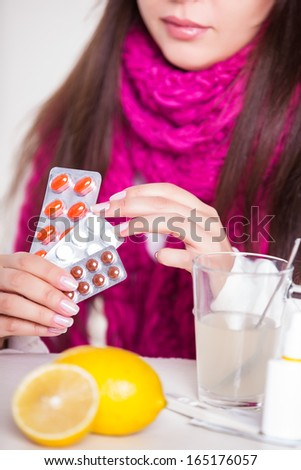 woman taking her medication