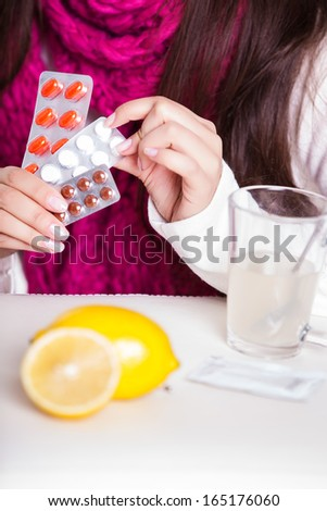 woman taking her medication - stock photo