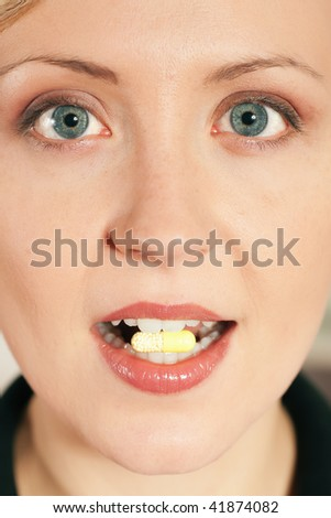 Woman taking in a pill
