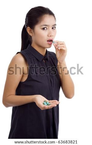 woman taking medicine, isolated on white background - stock photo