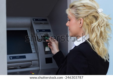 Woman taking money out