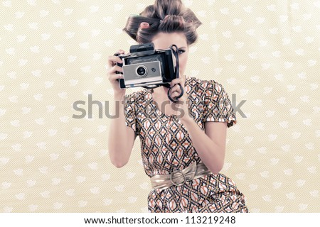 Woman taking photograph from vintage 4x6 film camera . - stock photo