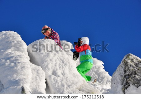 woman taking picture in the mountains  - stock photo