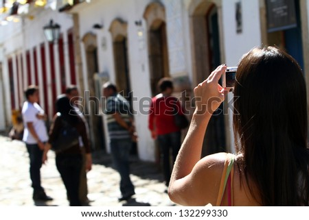 Woman taking pictures - stock photo