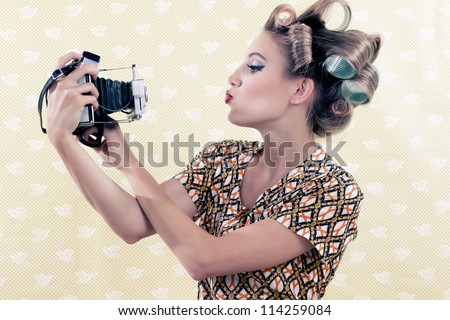 Woman taking self-portrait  from vintage 4x6 film camera . - stock photo