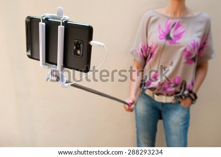woman taking selfie - stock photo