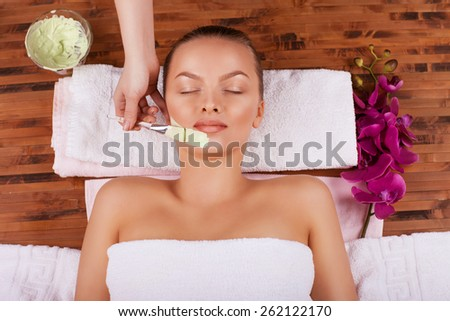 woman taking spa treatments and relaxation therapy