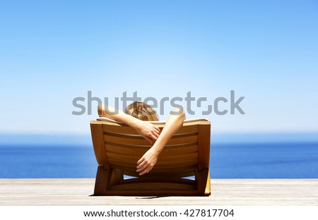 woman taking sunbath near swimming pool and beach