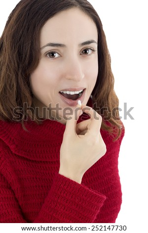 Woman taking tablet - stock photo