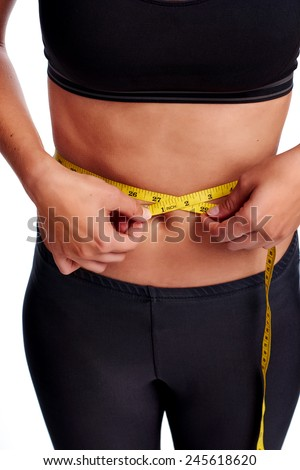Woman taking waist measurement with tape for thin weightloss healthy slimming diet - stock photo