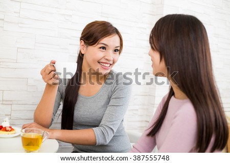 Woman talk to each other at coffee shop - stock photo