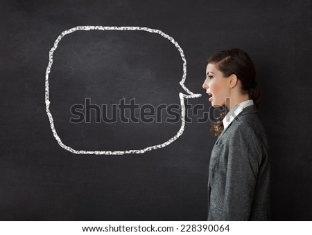 Woman talking blackboard/chalkboard concept - stock photo