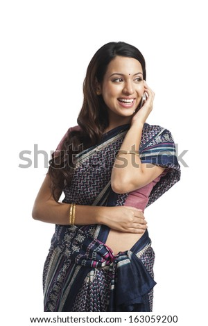 Woman talking on a mobile phone and smiling - stock photo