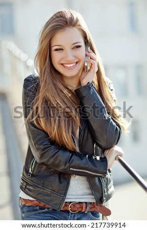 Woman talking on her mobile phone - stock photo