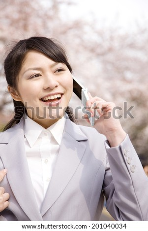 Woman talking on mobile phone - stock photo